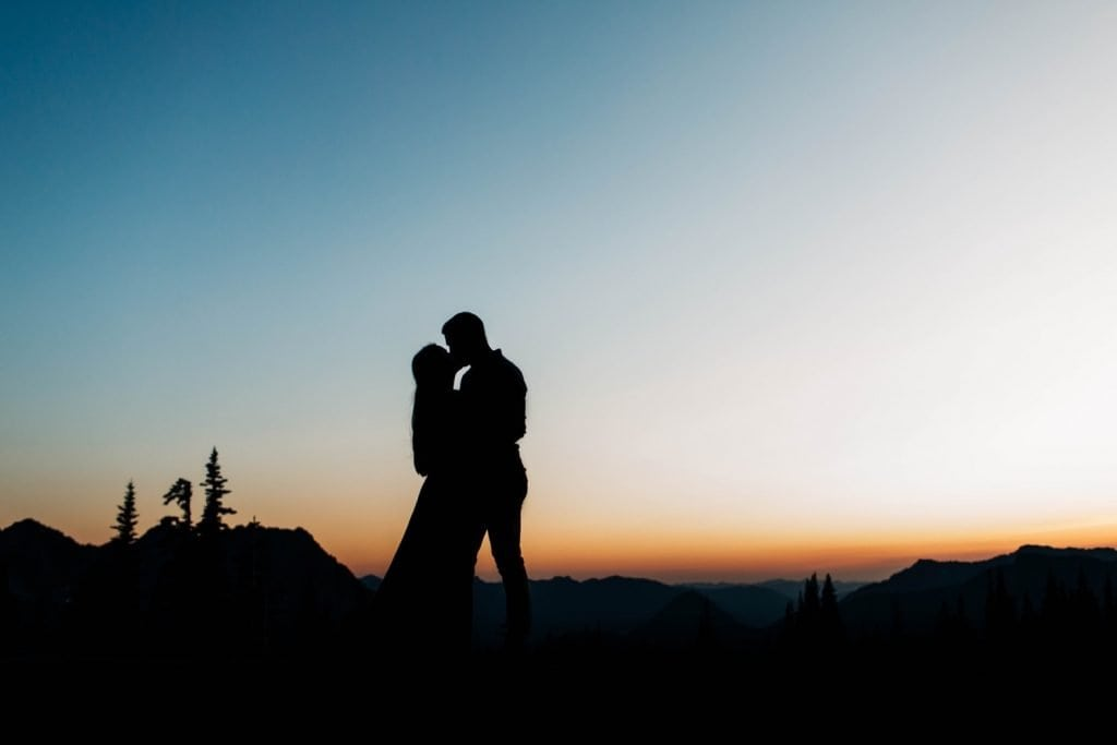 engagement photos in Seattle WA of couple at dusk in the mountains