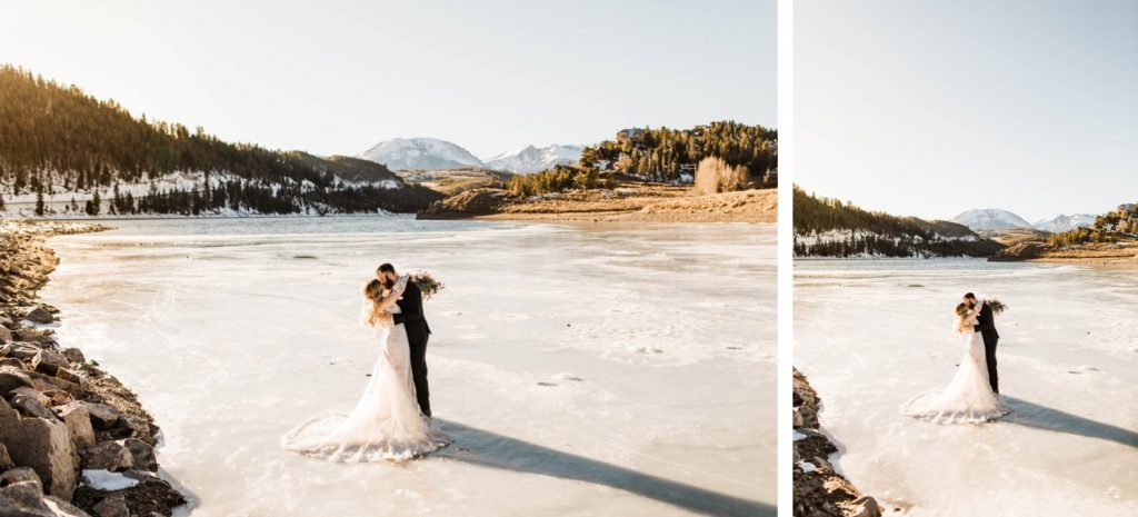 newly married couple standing on a frozen lake down the road after their Sapphire Point Overlook wedding