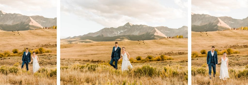 married couple walking through the mountains during their Telluride wedding sunset photos | image by Telluride wedding photographers