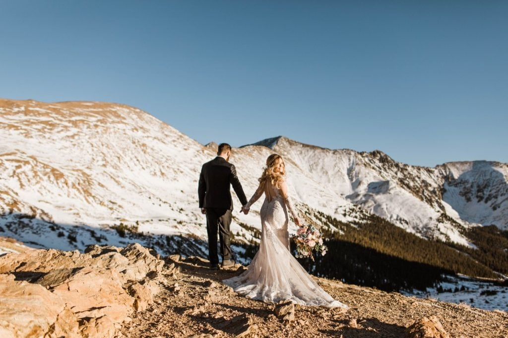 bride and groom hiking through the mountains near Sapphire Point Overlook after their wedding ceremony