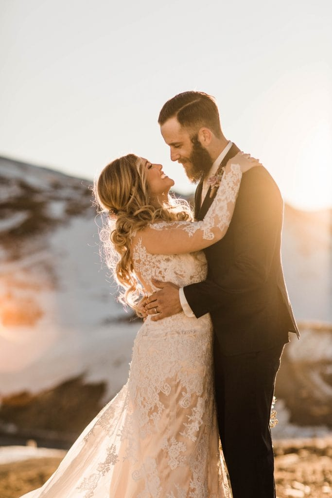 sunset photos of a newly married couple after their Sapphire Point Overlook wedding ceremony in Colorado