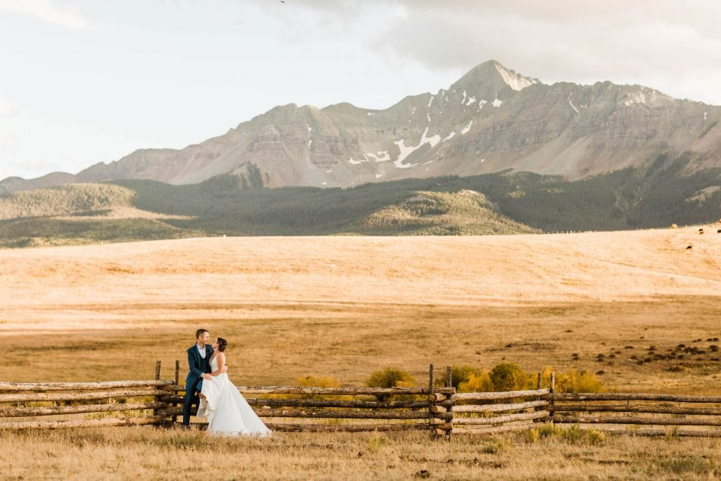 couple sitting together at a Wilson Mesa horse ranch wedding in Telluride | photo taken by Telluride wedding photographers
