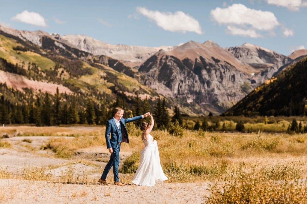 elopement definition example of a couple dancing in the San Juan mountains during their elopement wedding