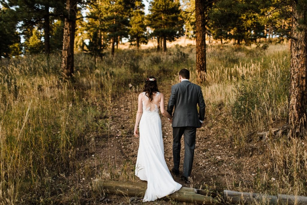 elopement definition example of a couple walking up a hiking trail during their elopement in Golden CO