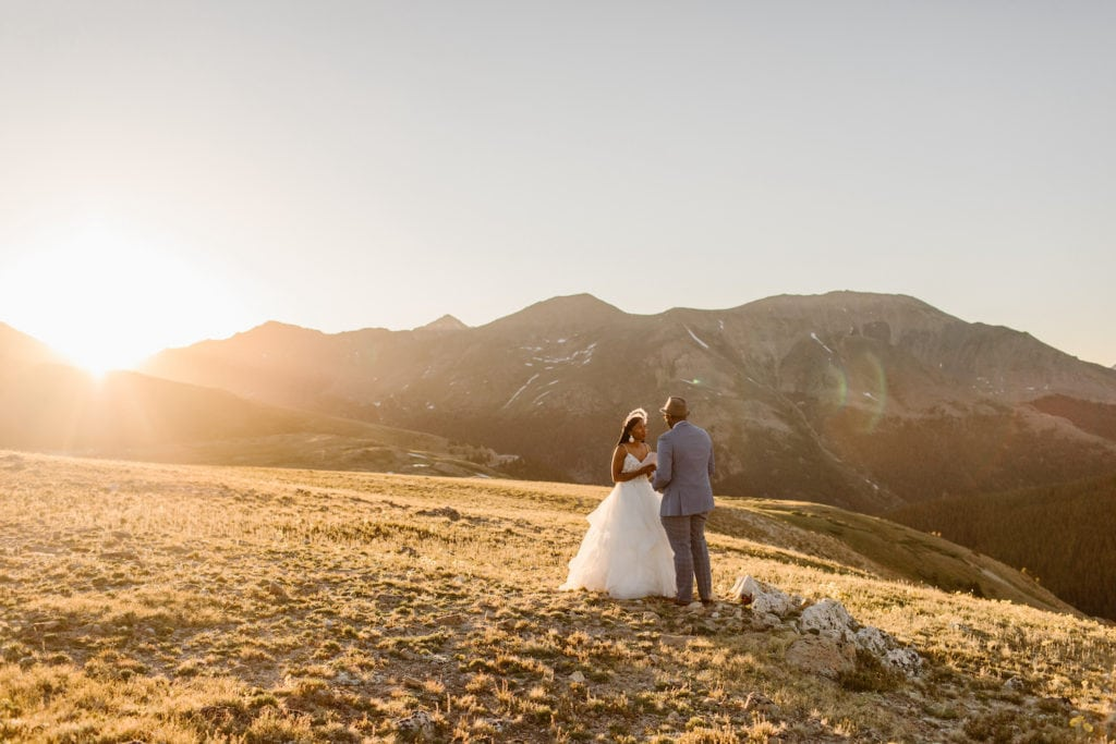 how to elope in Colorado without crowds | couple eloping on a hiking trail at sunrise on a weekday