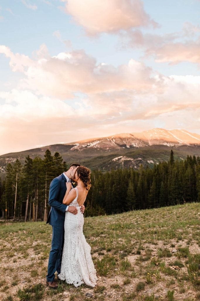 example of how to elope in Colorado | couple kissing at sunset during their Breckenridge elopement