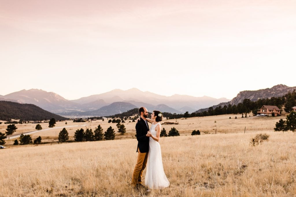 how to elope in Colorado | example of sunset elopement with couple dancing in an alpine meadow near Estes Park