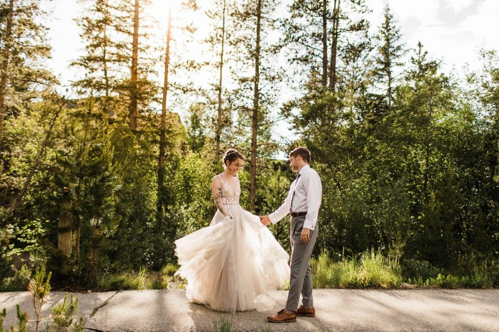 Colorado eloping couple dancing in the woods at sunset