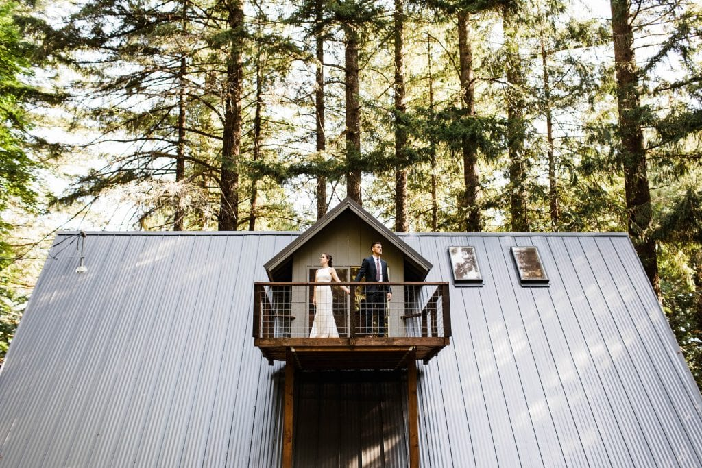 how to elope in Washington State couple celebrating elopement at cabin in the woods of Washington State