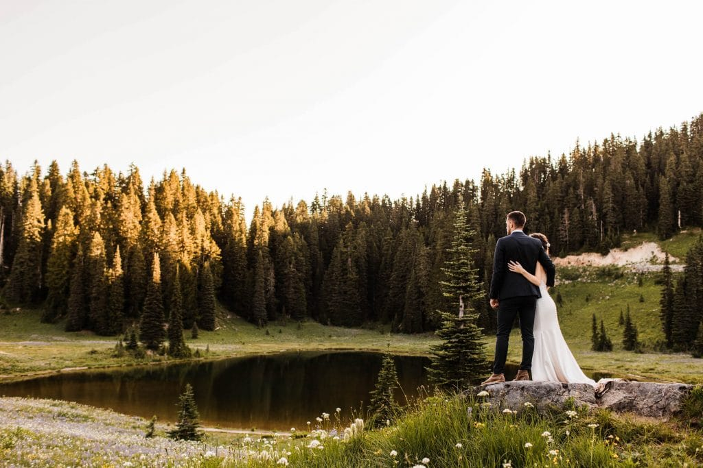 how to elope in Washington State | eloping couple enjoying the view of an alpine lake in the Washington mountains before their elopement ceremony