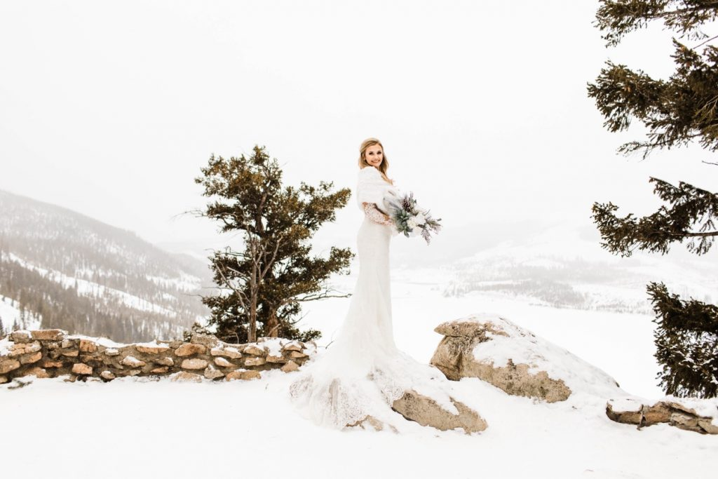 snowy bridal photos in the snow at Sapphire Point Overlook
