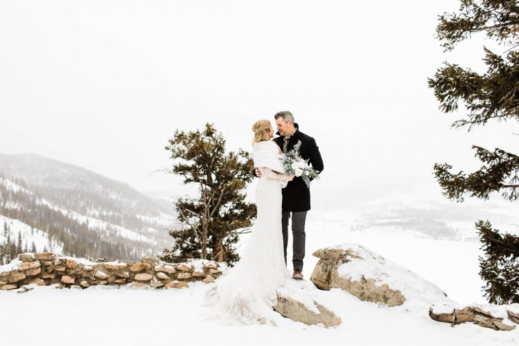 couple kissing before their Sapphire Point elopement in the middle of winter
