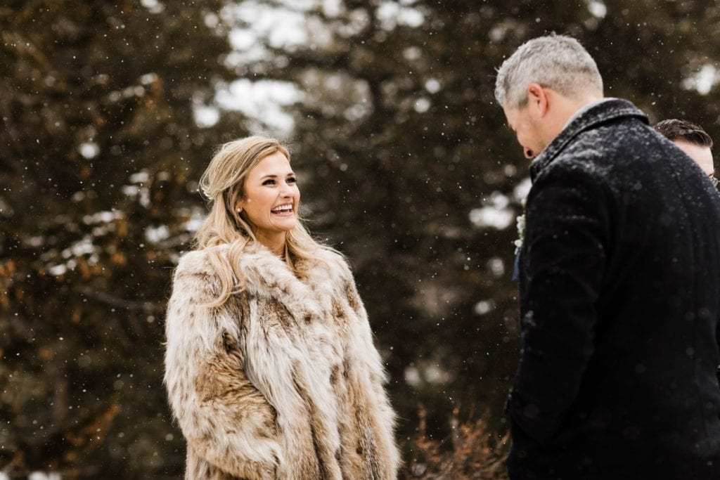 bride smiling at groom during their winter Sapphire Point elopement
