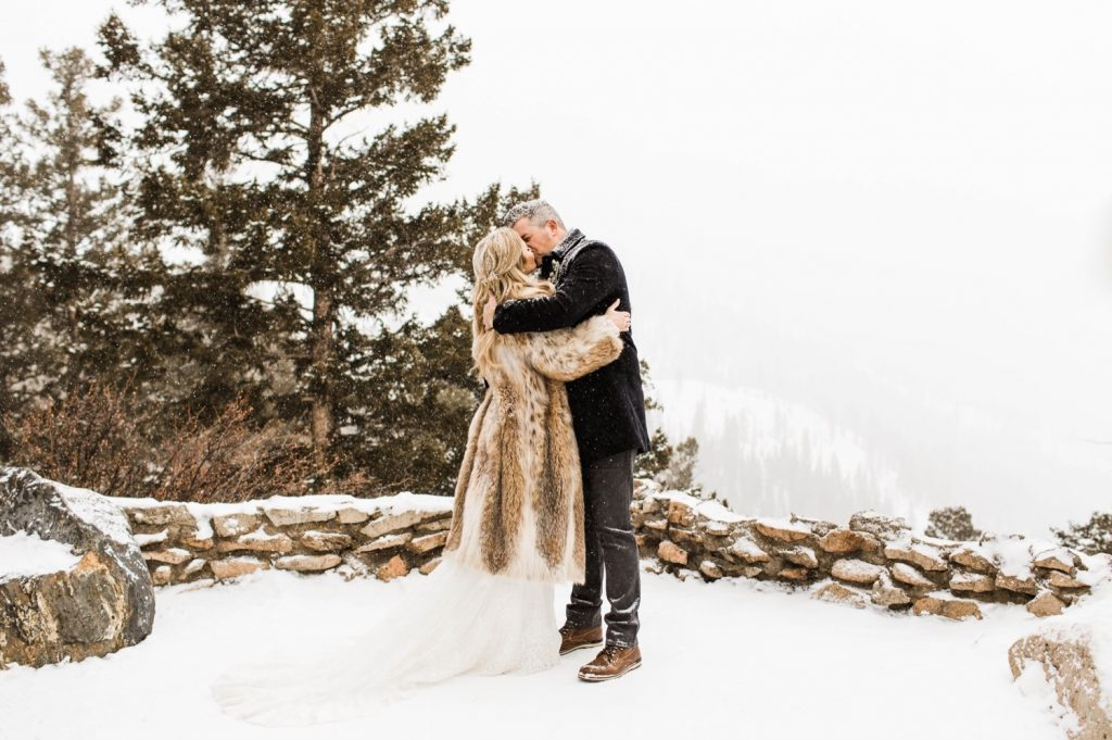 eloping couple sharing their first kiss during their winter Sapphire Point elopement ceremony