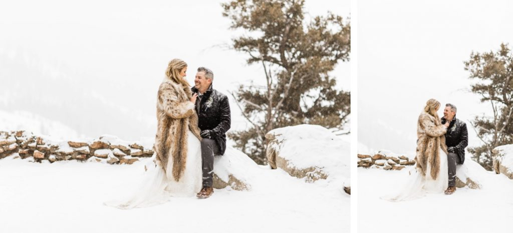 eloping couple watching snow fall during their Sapphire Point elopement in the winter
