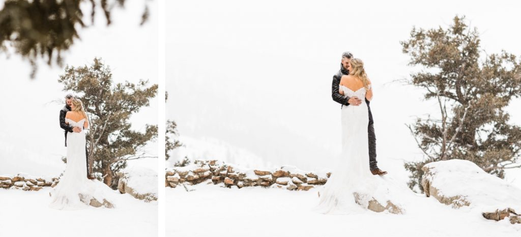 eloping couple snuggling up in the snow at Sapphire Point Overlook in Colorado