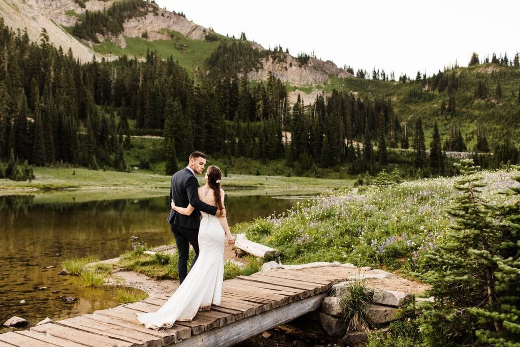 adventurous couple eloping in the mountains in the summertime