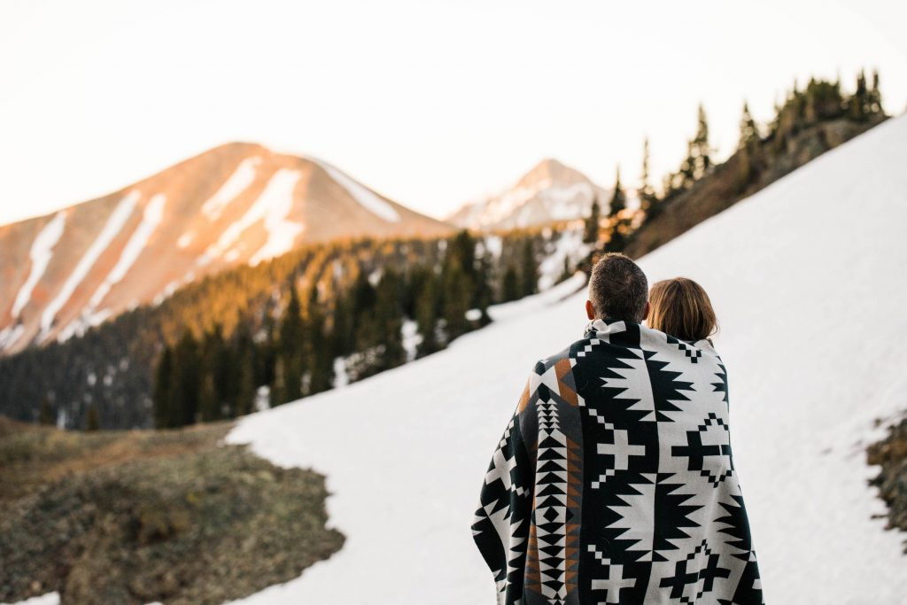 couple eloping in the mountains while watching the sun rise in the San Juan mountains