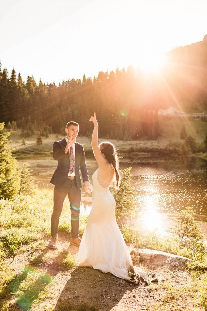couple's first dance during their Mt Rainier National Park elopement adventure wedding while the sun shines behind them