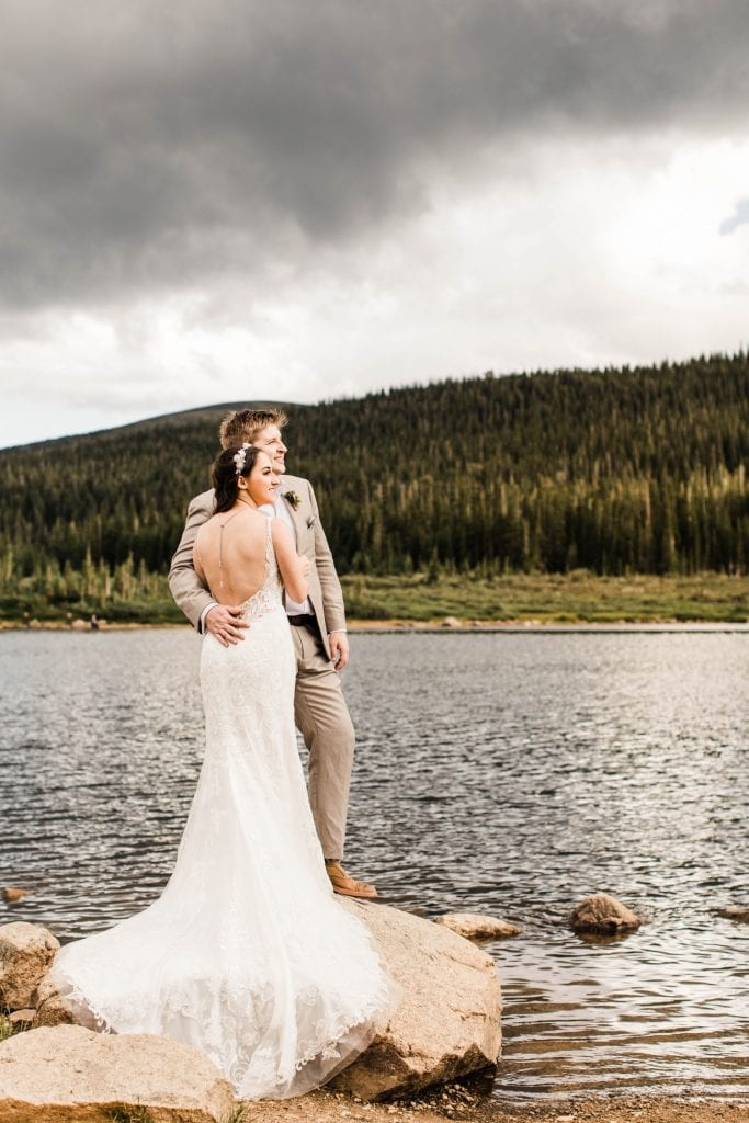 mountain wedding in Colorado Rocky Mountains by an alpine lake after a storm rolled in