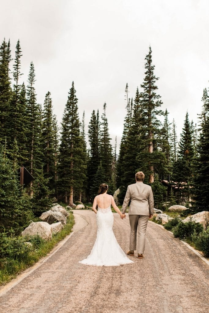 Colorado couple walking to the trailhead in the Indian Peaks after their Colorado mountain wedding
