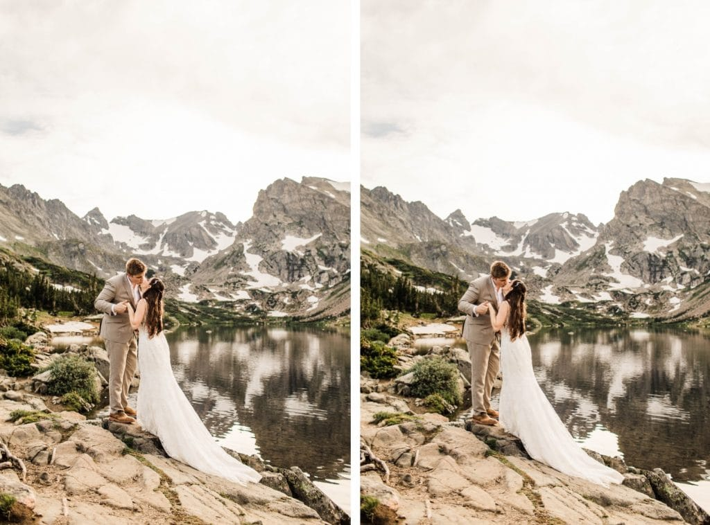 married couple hiking up a rock by an alpine lake during their mountain wedding in Colorado