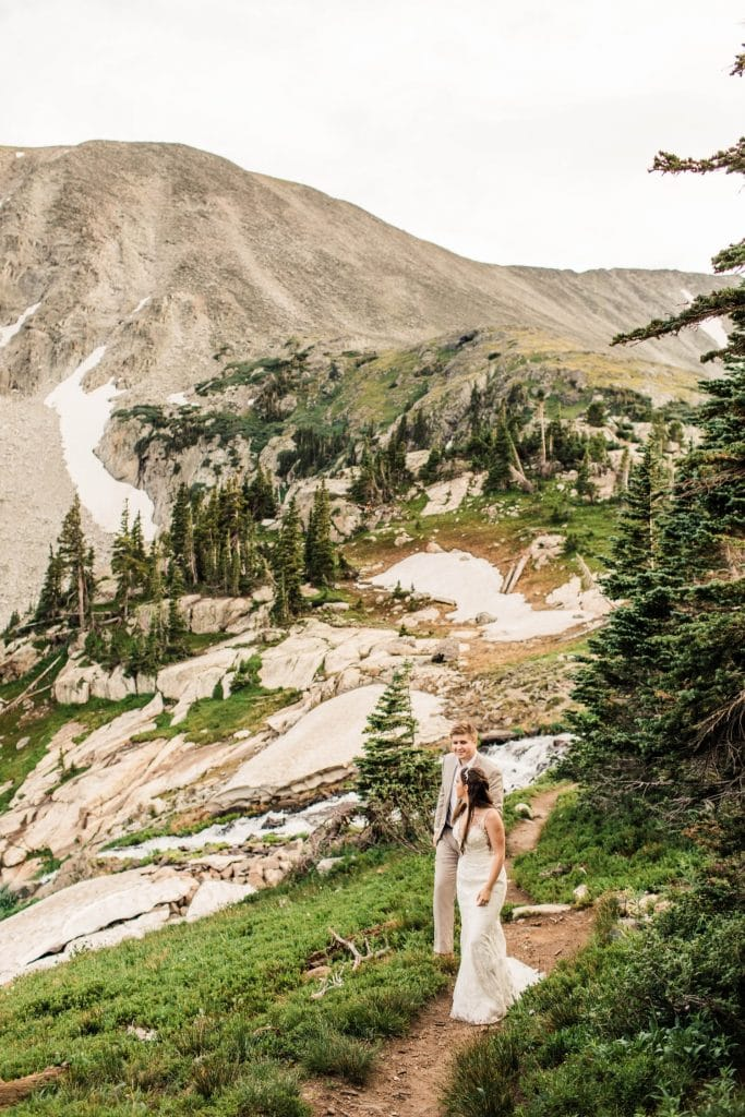 hiking wedding photos taken by Colorado mountain wedding photographers