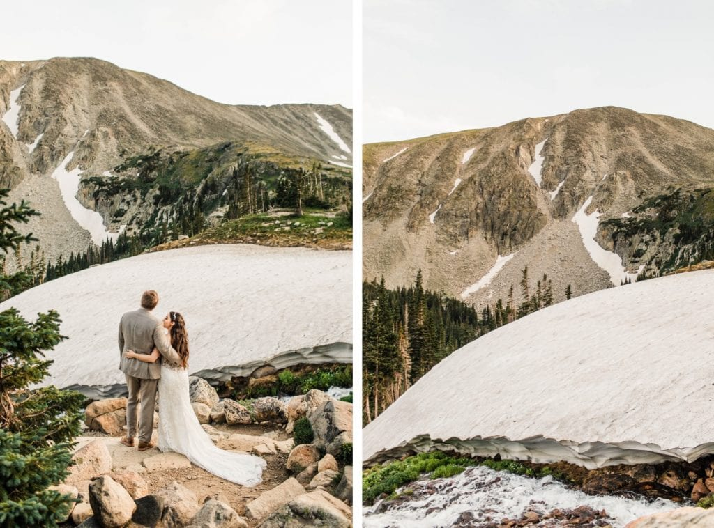couple admiring the view in the mountains photographed by Colorado mountain wedding photographers