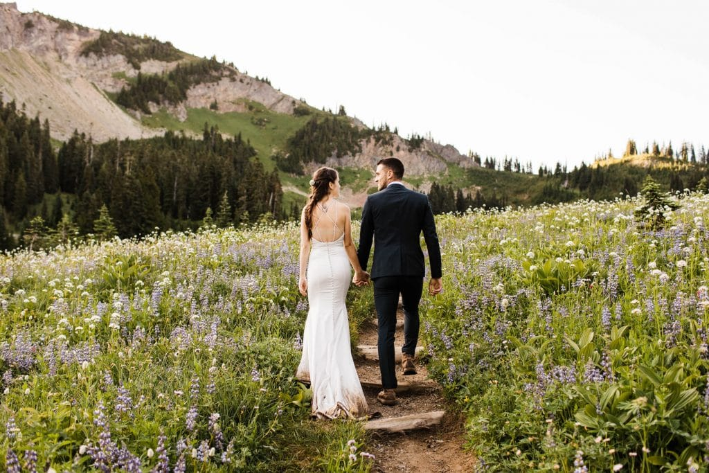 eloping bride hiking down a trail in her hiking wedding dress