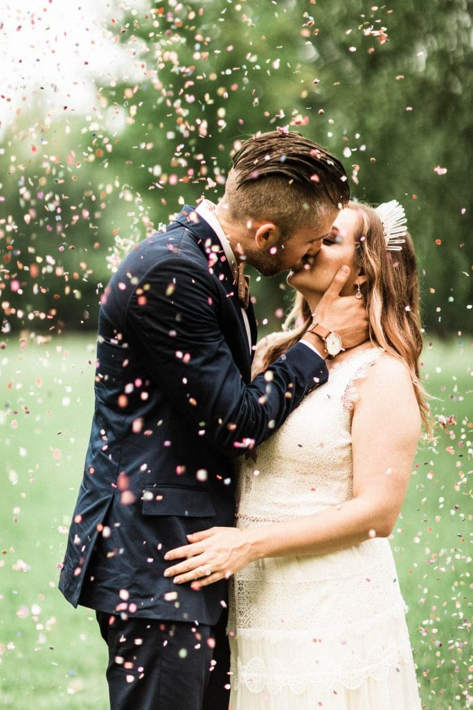 what does it mean to elope | couple eloping with confetti