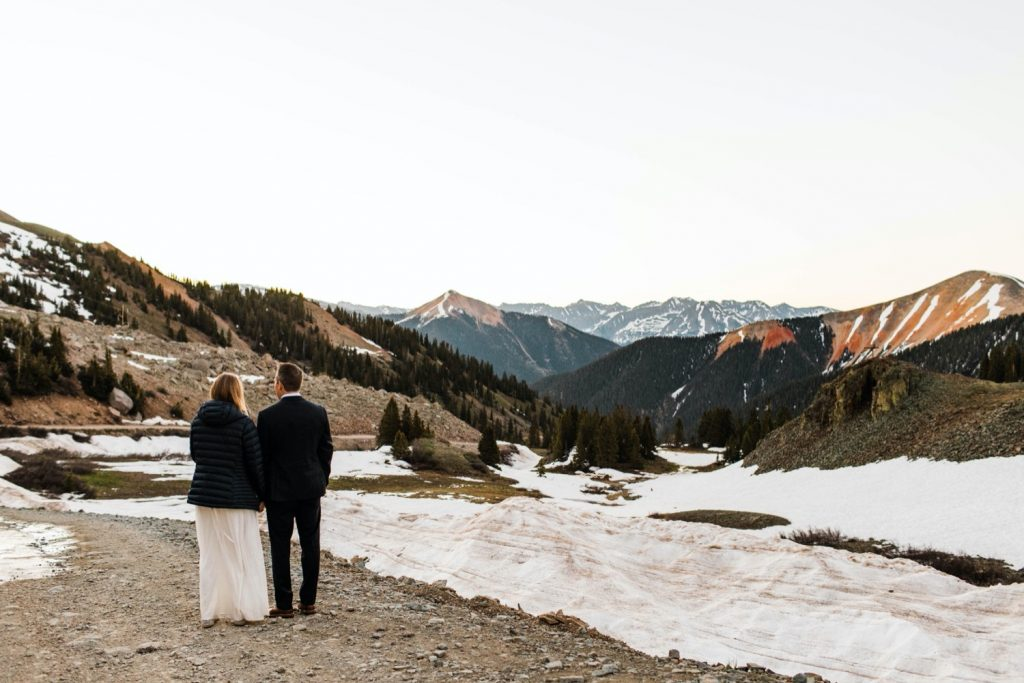 couple enjoying the view of the mountains during a Telluride elopement at sunrise