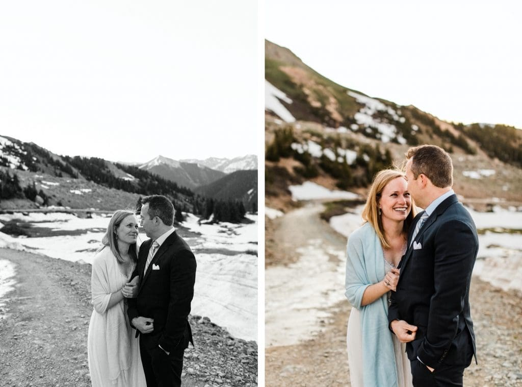 eloping couple snugging up together to stay warm during their sunrise Telluride elopement