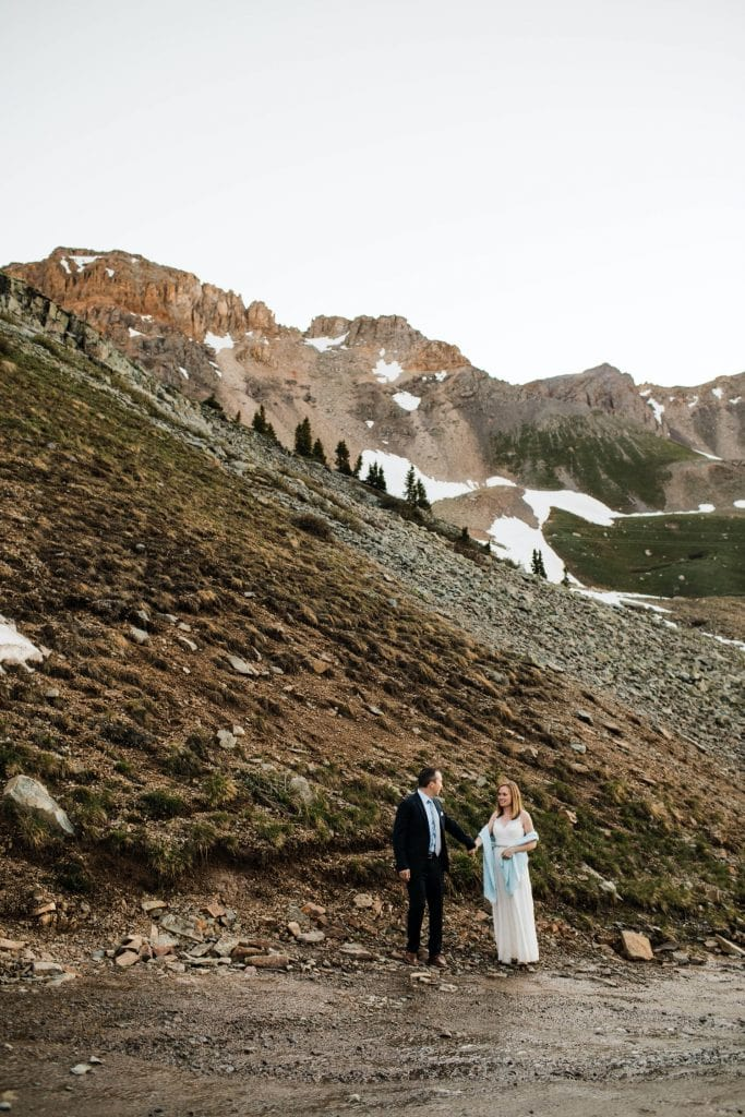 photo of a couple hiking through the mountains, taken by a Telluride elopement photographer