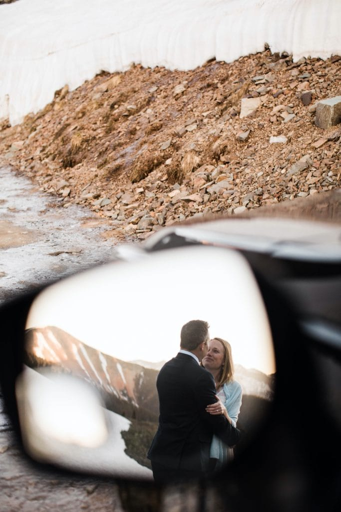 reflection of eloping couple in a car mirror taken by a Telluride elopement photographer