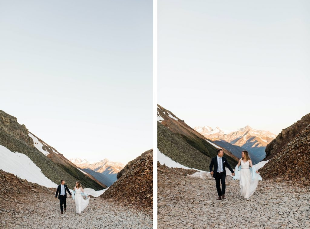 eloping couple running down a mountain pass outside of Telluride Colorado