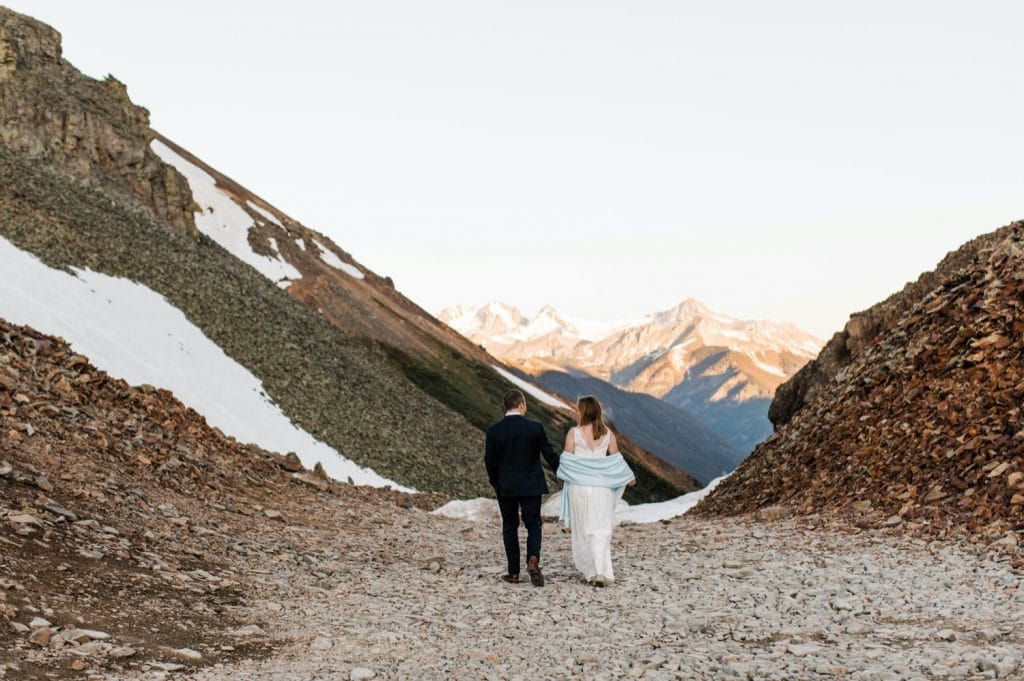 eloping couple hiking down a trail during their Telluride elopement