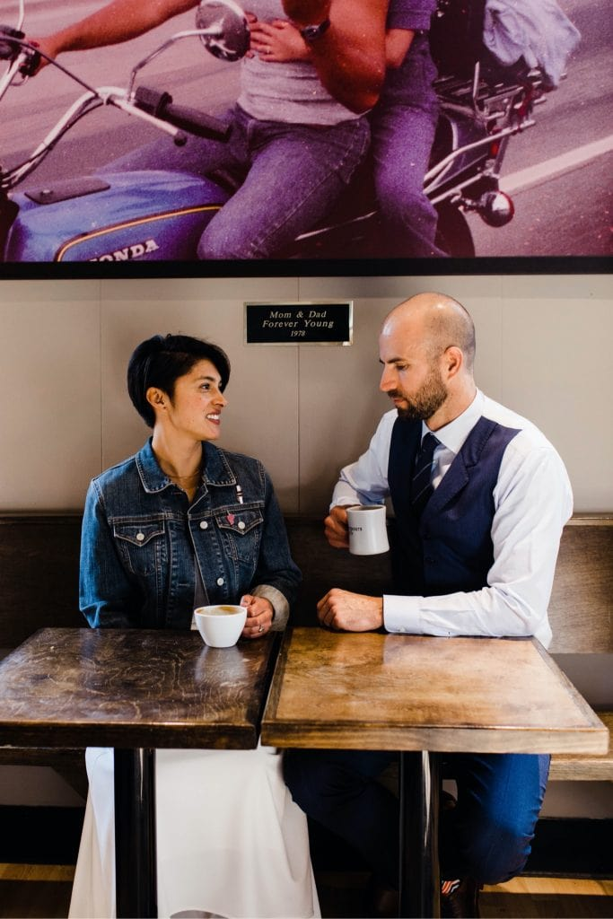 couple hanging out at a coffee shop before their wedding at Denver Botanic Gardens