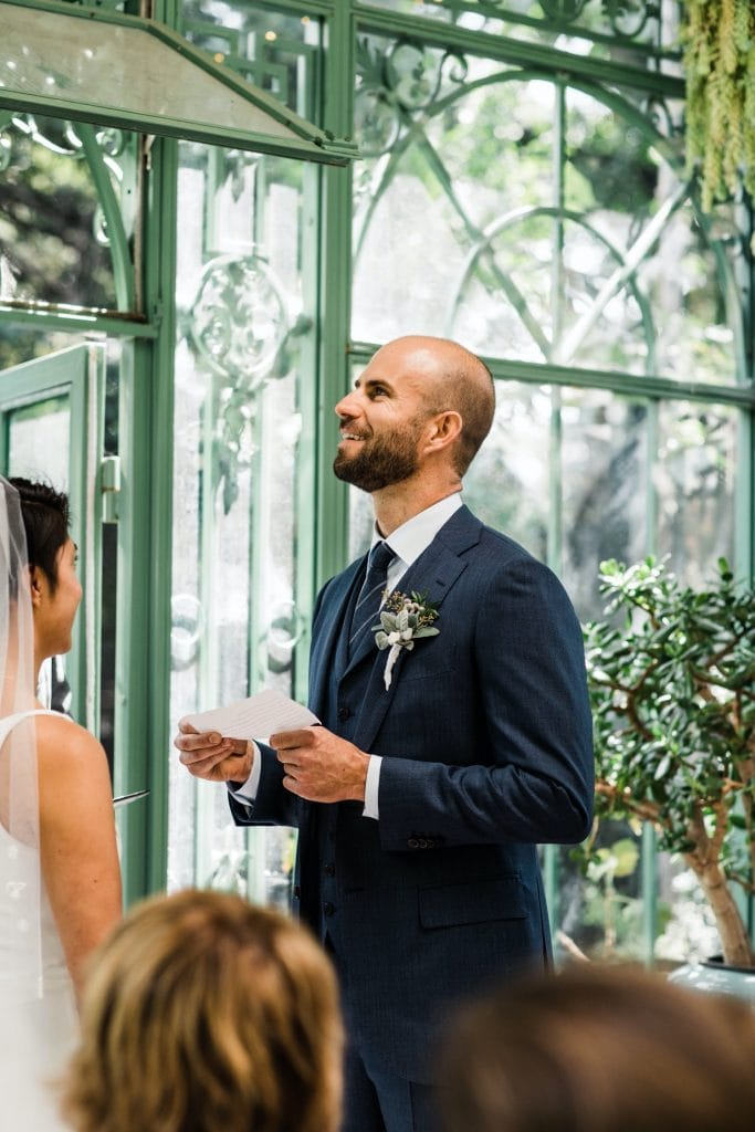 Denver Botanic Gardens wedding vow reading in a greenhouse