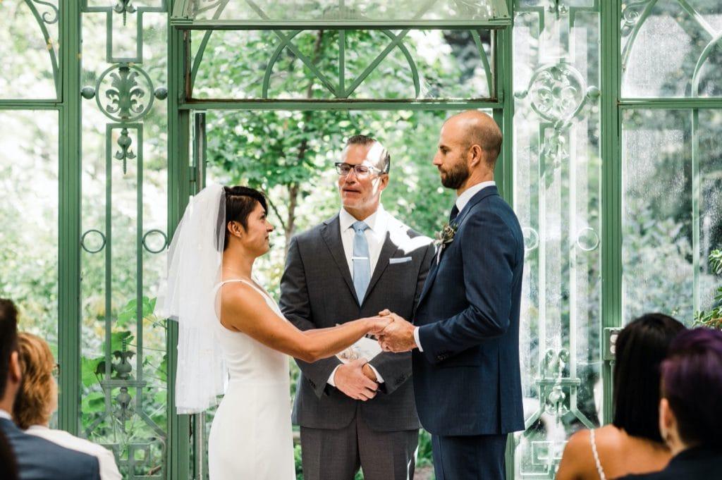 small Denver Botanic Gardens wedding ceremony in a greenhouse