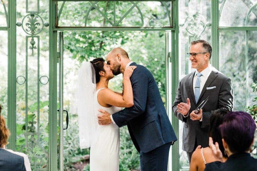 first kiss during a Denver Botanic Gardens wedding ceremony