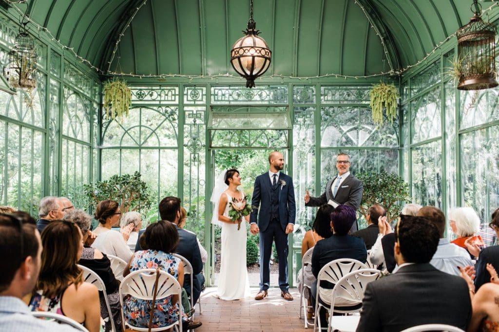 recessional at Woodland Mosaic solarium after a Denver Botanic Gardens wedding ceremony