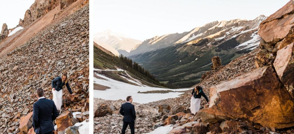eloping couple scrambling down a rocky mountainside after saying their vows outside of Telluride