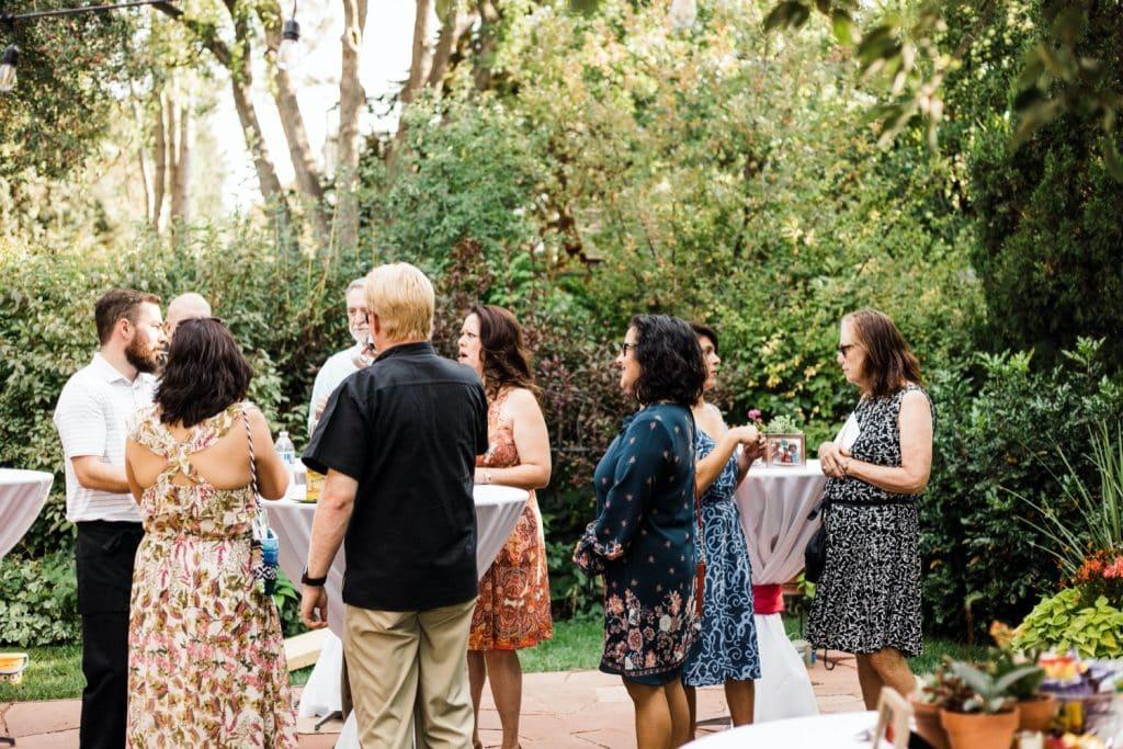 people mingling at cocktail hour after a Denver Botanic Gardens wedding