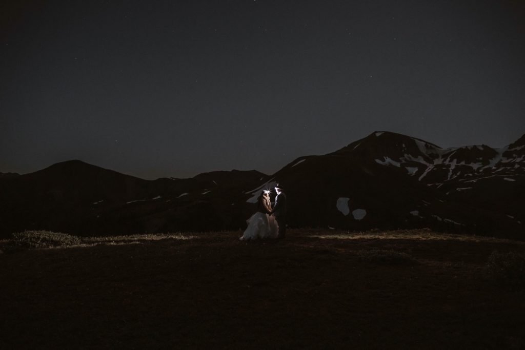 couple hiking in the dark for their Aspen Colorado elopement
