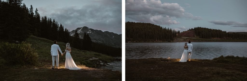 couple hiking to their micro lake wedding in Colorado at dawn