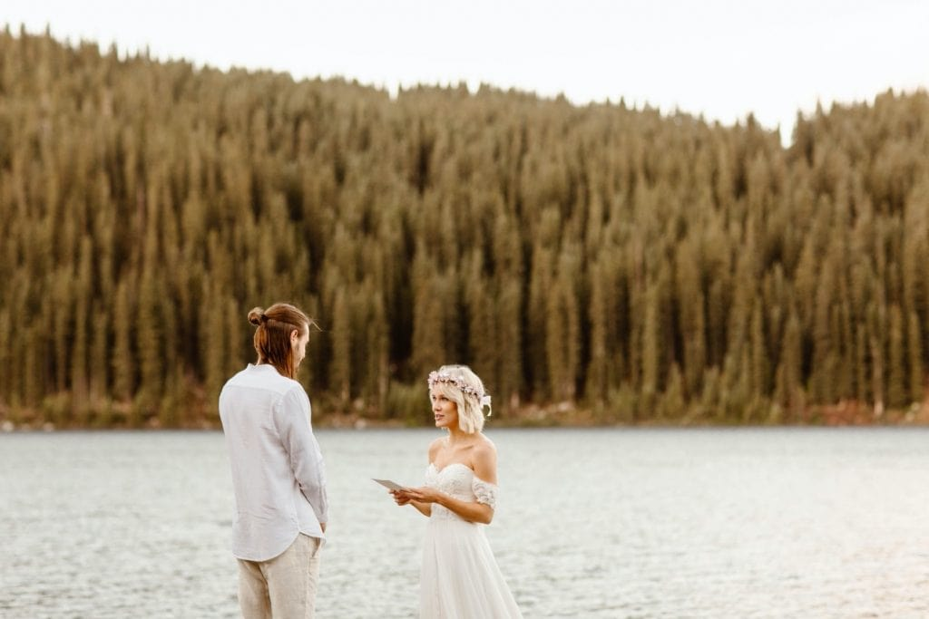 vow reading during a tiny lake wedding Ceremony