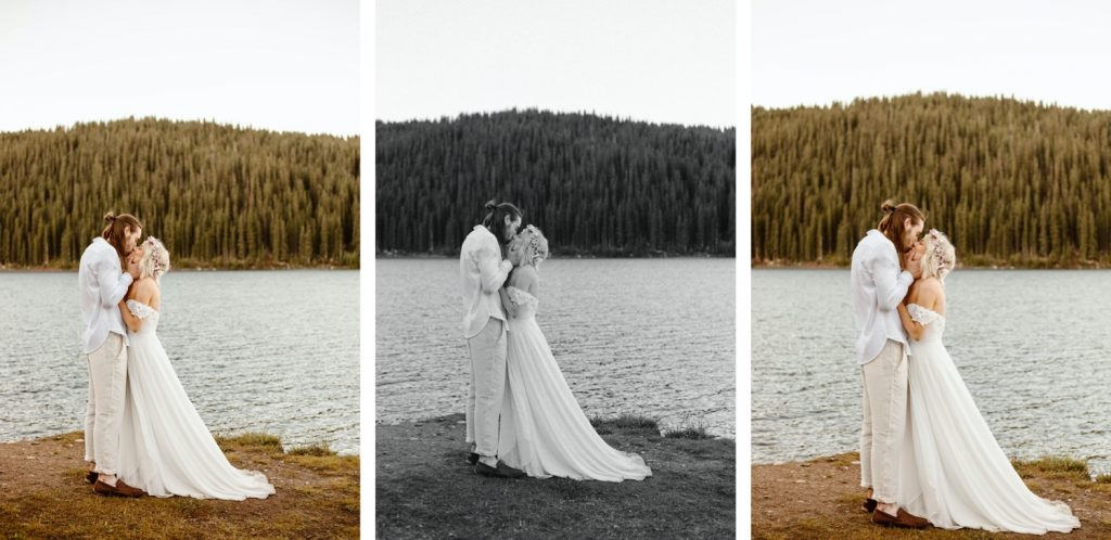 couple having their first kiss during their lake wedding ceremony in Colorado