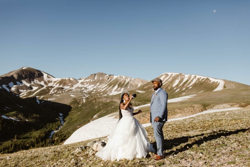 couple drinking champagne after their Aspen Colorado elopement to celebrate
