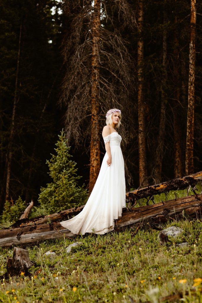 bride in the woods after their small lake wedding in Colorado