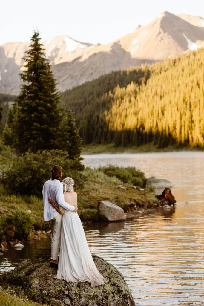 couple gazing out at the water during their lake wedding in Colorado